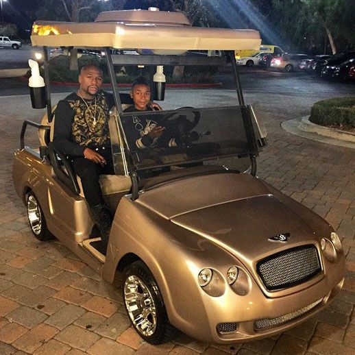 Floyd Mayweather in his gold Bentley custom golf cart