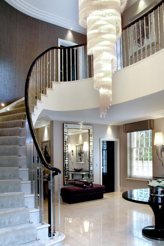 A glass chandelier provides the focal point for the for Focal point flooring