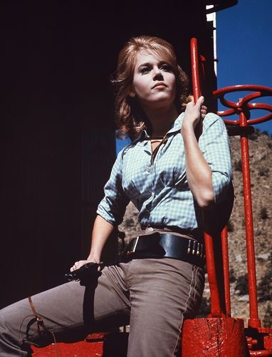 Jane Fonda as the female outlaw, 'Cat Balou' between scenes in Colorado.