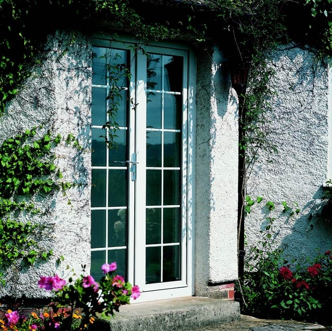 Upvc French doors - I like this 'square' pattern on the windows (it would at least help discourage birds from flying into them as well as look good!)