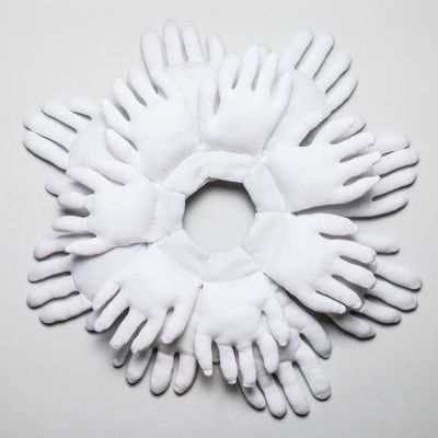 Zoe Brand - She was the promise of her generation, 2017, White cotton gloves that were inadvertently stolen from gallery install jobs between 2014 - 2017, siliconised polyester stuffing, and white cotton thread, Approx 600mm diameter x 200mm - $1000 (photo Andy Mullens)