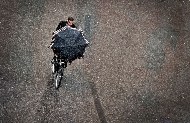 A man rides a bicycle on a snowy day on Nov. 29 in Munich, southern Germany. (Victoria Bonn-Meuser/AFP/Getty Images) #