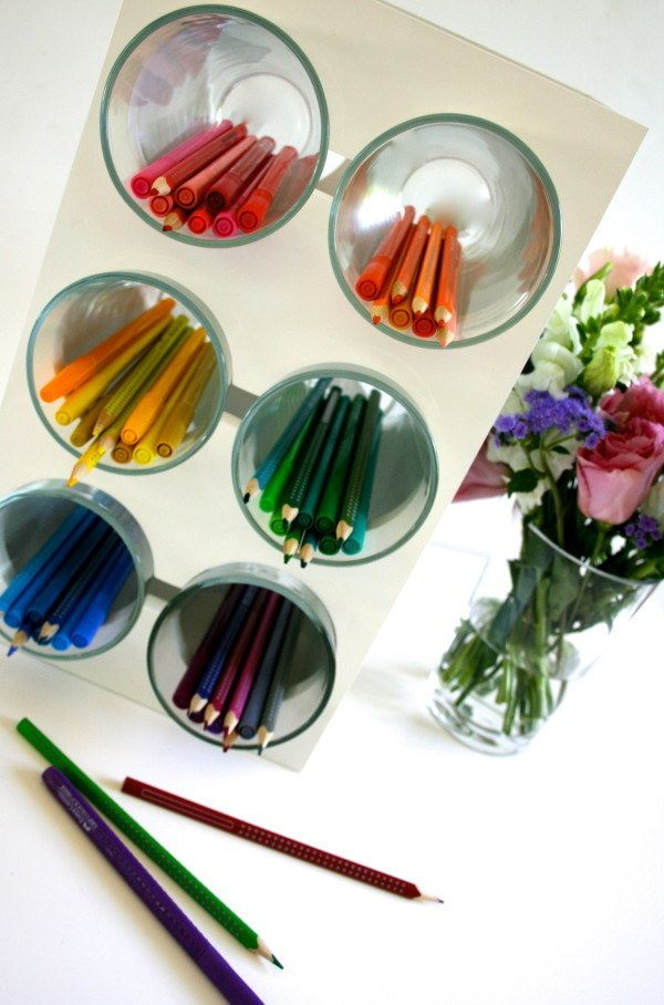 Place cups in a wine rack and use them to store pens and pencils. | 35 Cheap And Ingenious Ways To Have The Best Classroom Ever