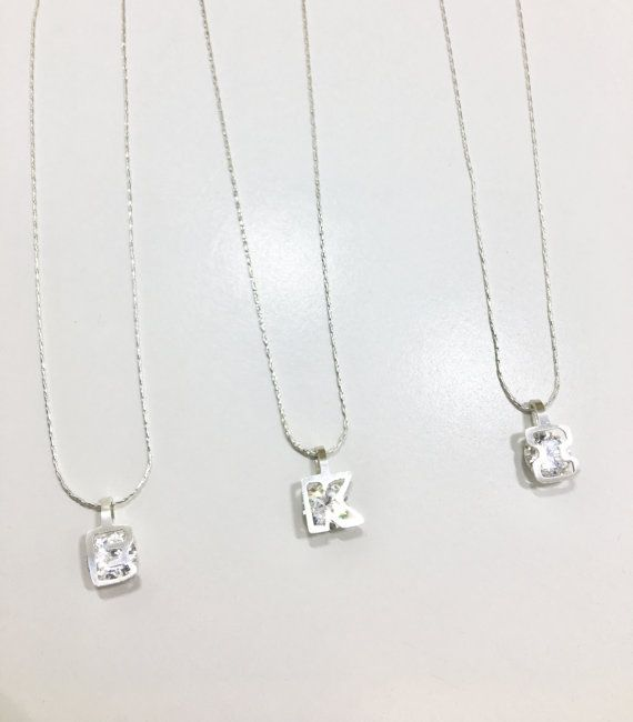 Simple, elegant and unique. It is one of our Shape your diamond collection. They made a perfect gift for you or your friends! This necklace is designed and made by me. The design of this necklace is simple but it showed some uniqueness. Its like you are wearing a special shape diamond. The cubic zirconia (CZ) was round and was presure set underneath the Letter frame. You can choose the one for your initials.  The pandent is made of sterling silver and measured at approx 12mm x 15mm (depends…