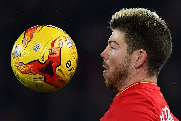 Liverpool's Spanish defender Alberto Moreno controls the ball during the English League Cup quarter-final football match between Liverpool and Leeds United at Anfield in Liverpool, north west England on November 29, 2016. / AFP / Paul ELLIS / RESTRICTED TO EDITORIAL USE. No use with unauthorized audio, video, data, fixture lists, club/league logos or 'live' services. Online in-match use limited to 75 images, no video emulation. No use in betting, games or single club/league/player…