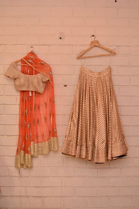 Gold striped lehnega with coral dupatta                                                                                                                                                     More