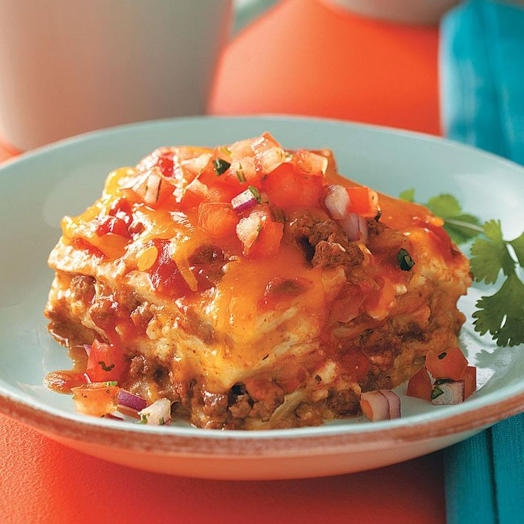 """Beef Enchilada Lasagna Casserole Recipe -""""Whenever I make this cheesy layered casserole, my guests rave about it and ask for the recipe. I serve it with French bread or toasted garlic bread."""" —Charlene Griffin, Minocqua, Wisconsin"""