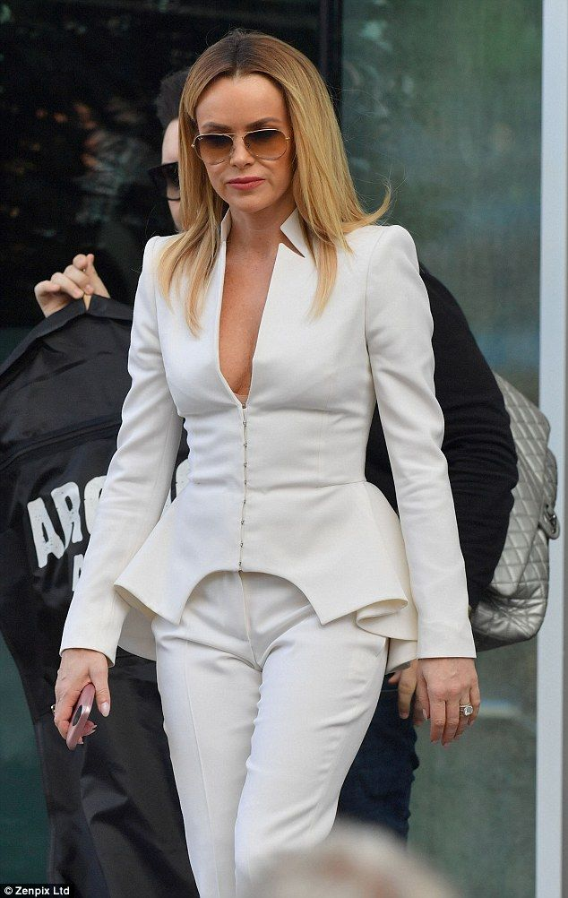 Something on your mind?Amanda Holden didn't seem to be in any better spirits as she left ...