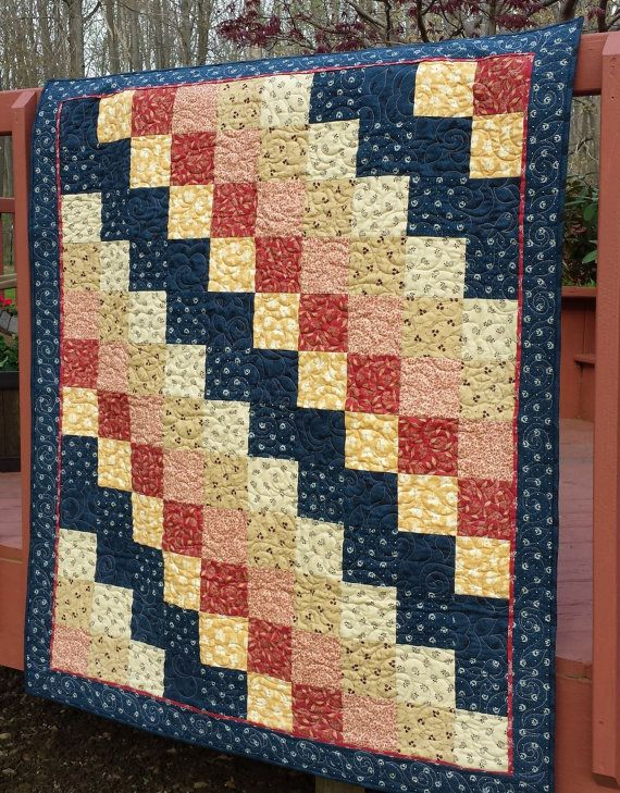 Buy Lap Quilt, wall hanging, diagonal patchwork, 48 x 54, machine quilted, country primitive colors, blue, deep red, beige, pale gold by warmandcozyquilts. Explore more products on http://warmandcozyquilts.etsy.com