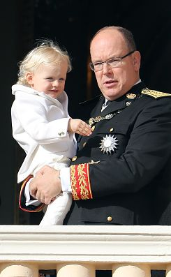 Prince Albert II of Monaco (R) holding Prince Jacques appear on the balcony of the Monaco Palace during the celebrations marking Monaco's National Day, on November 19, 2016 in Monaco.