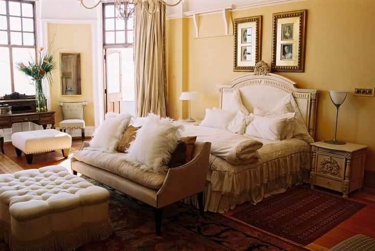 Sophisticated, elegant interiors in a century old Johannesburg mansion with large imposing rooms and impressive architectural detail.  Bedroom in romantic French Provencale style