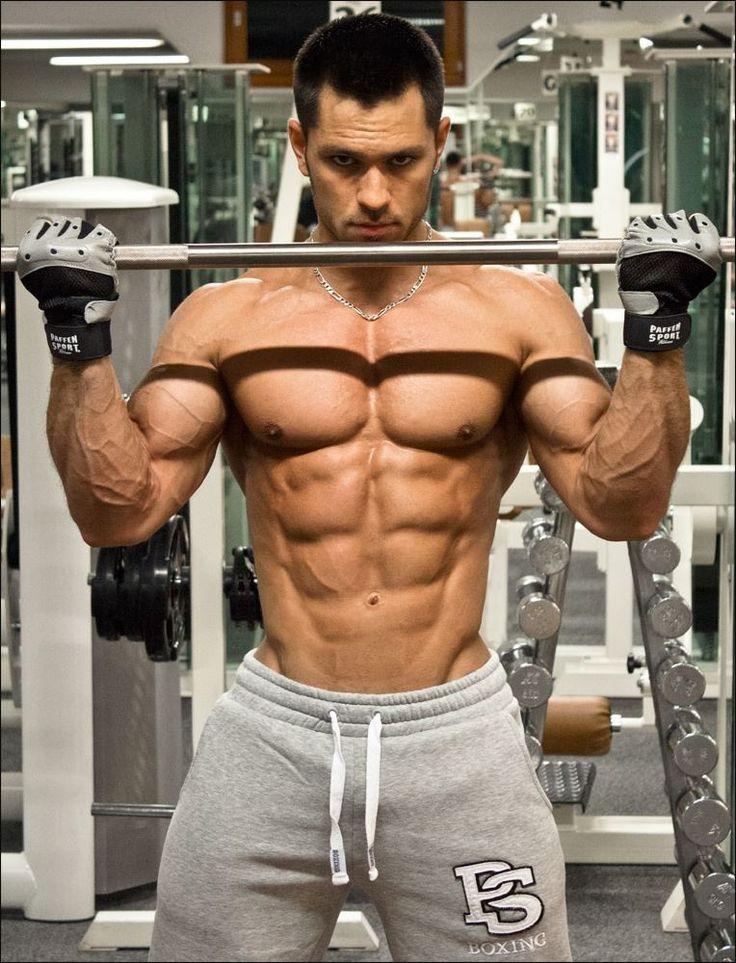 big beefy hunk with huge biceps guns of steel. Black Bedroom Furniture Sets. Home Design Ideas