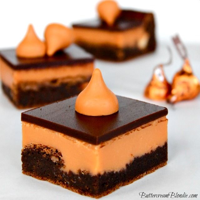 Pumpkin Kiss Brownies Recipe ~  rich, yet not heavy.  They have a warmth to them that sets the stage perfectly for the pumpkin kiss ganache which is as smooth and silky as butter.  All tucked under a layer of dark chocolate glaze.