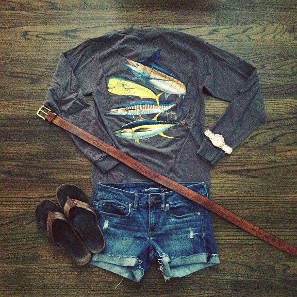 Medium wash shorts with gray long sleeved guy Harvey tshirt and brown leather flip flops with belt