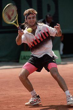 Tennis superstar Andre Agassi wears the Air Tech Challenge shoe by Nike in  the 1990 French