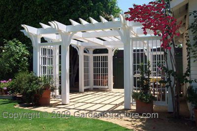 backyard trellis built around deck to create privacy from neighbors: climbing roses or wisteria....