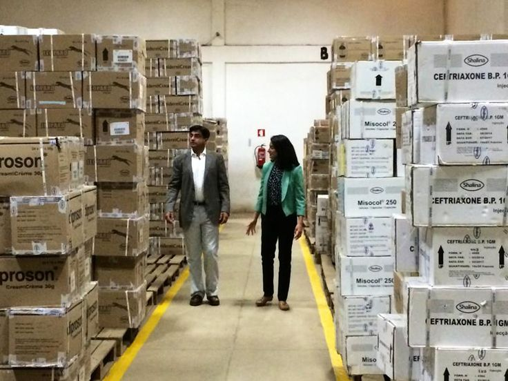 Brother and sister team, Abbas and Shalina Virji, Co-CEOs of Shalina Healthcare, check stock at one of their Luanda depots