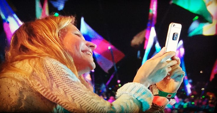Gwyneth Paltrow proudly captures her children singing along with dad Chris Martin & Coldplay on the pyramid stage at 'Glasonbury 16'