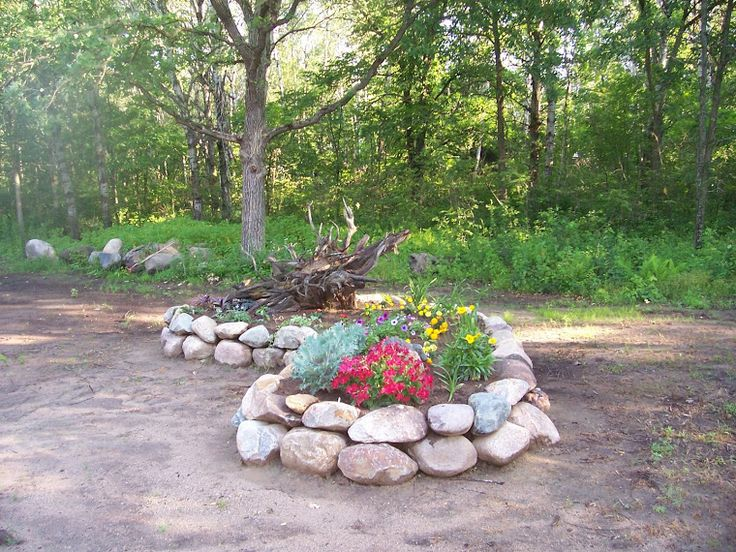 Raised bed rock borders rock garden we have done for Rock garden bed ideas
