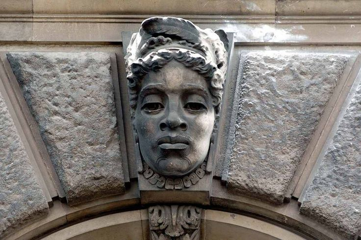 A stone sculpture of an African woman on the Cunard Building in Liverpool