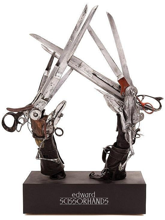 "Scissor-hands display from Edward Scissorhands. Estimated Price: $12,000 - $15,000, (TCF, 1990) This pair of signature Johnny Depp ""Edward Scissorhands"" glove props were fabricated to be worn by Depp as his central costume pieces in the film. The scissor-hands are expertly constructed of cast hard rubber components meticulously studio-painted to simulate realistic and sharp scissor blades. The blades are affixed to rigid plastic handles ..."