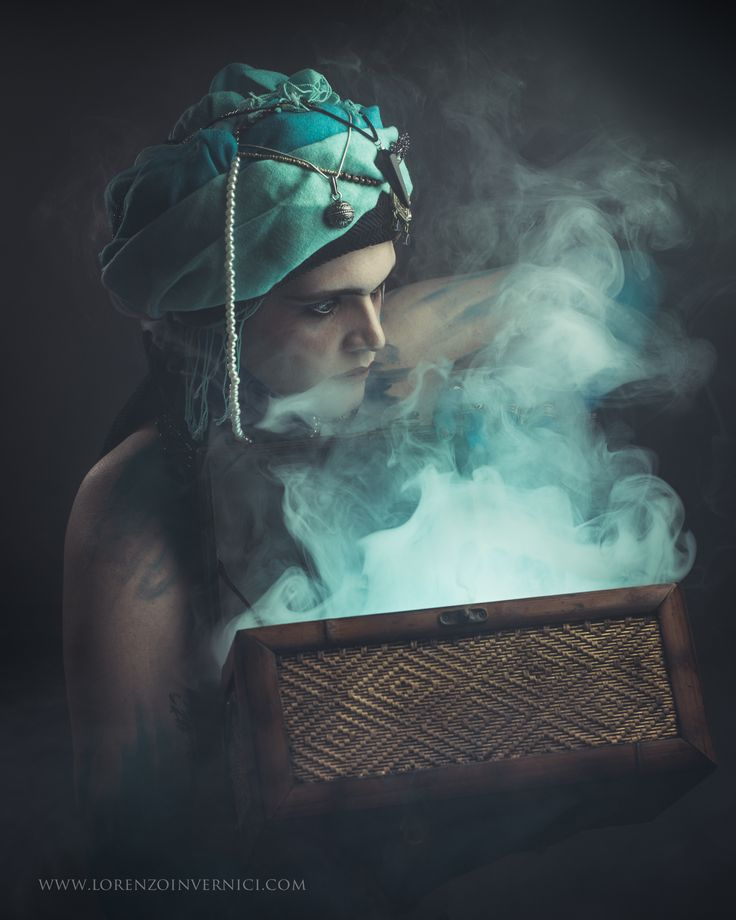 Creative Portrait of Marcello - The Genie Keywords: smoke, dramatic, strobist, hasselblad, blue