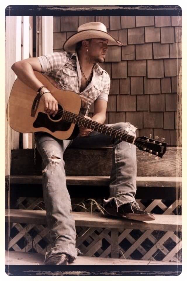 Nothing Hotter than a man with a cowboy hat and guitar