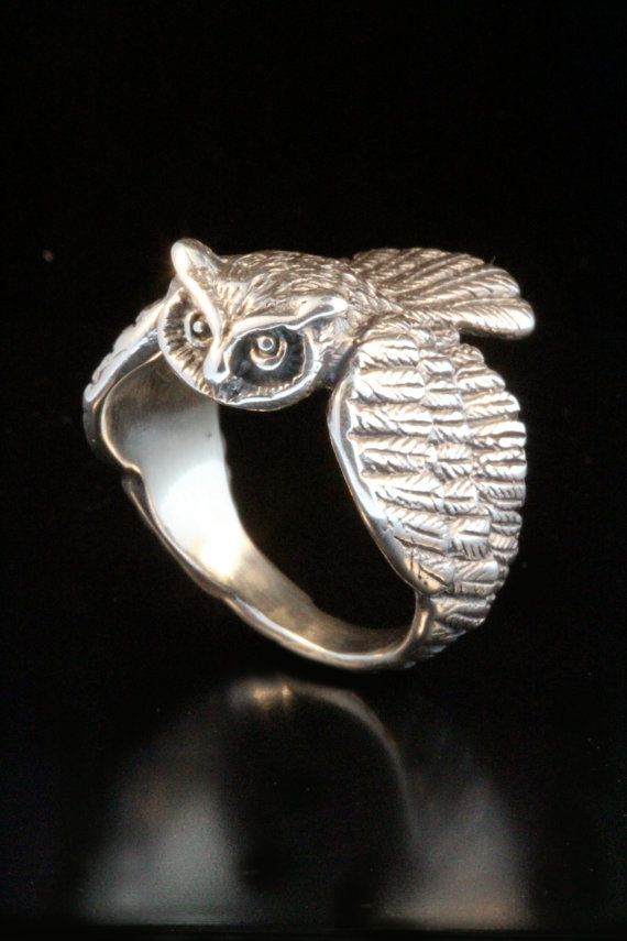 The wings on this solid sterling silver Owl Ring wrap gracefully around the finger. The owl is 1 long from beak to tail. This striking ring is