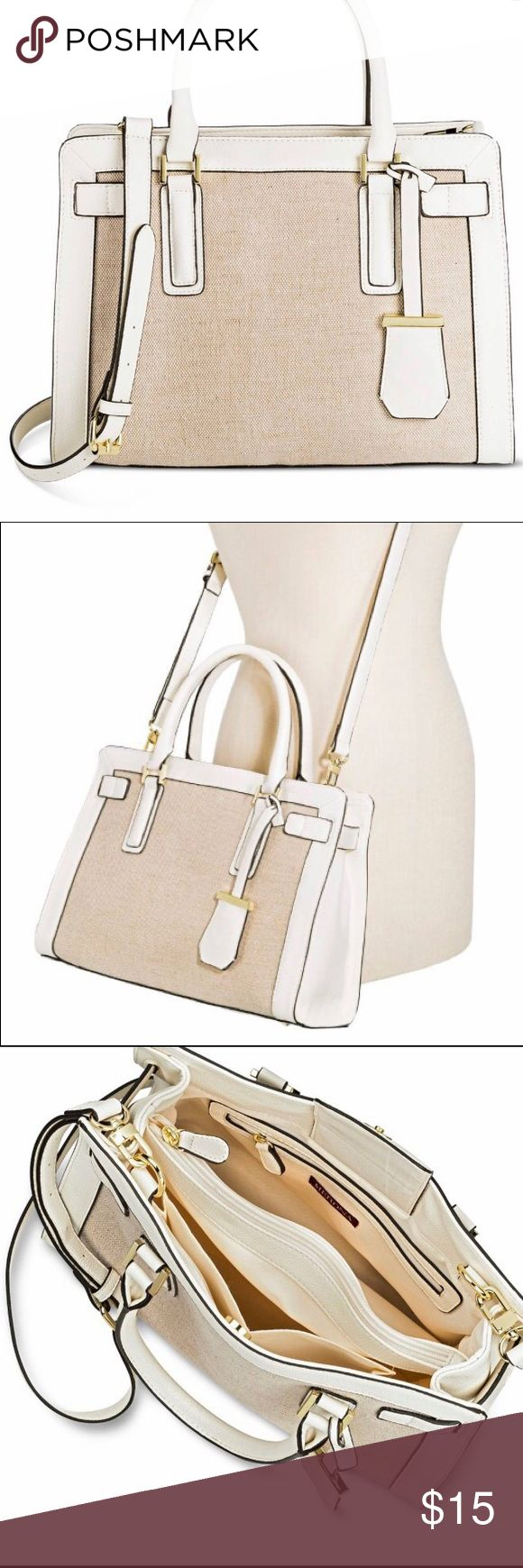 Merona faux leather tote Only worn a few times, this white and tan tote can go with any outfit and has impeccable storage space for all your traveling needs. 3 large pockets on inside (including a zipper pocket), and also a divider which doubles as a giant pocket. Willing to negotiate price Merona Bags Totes