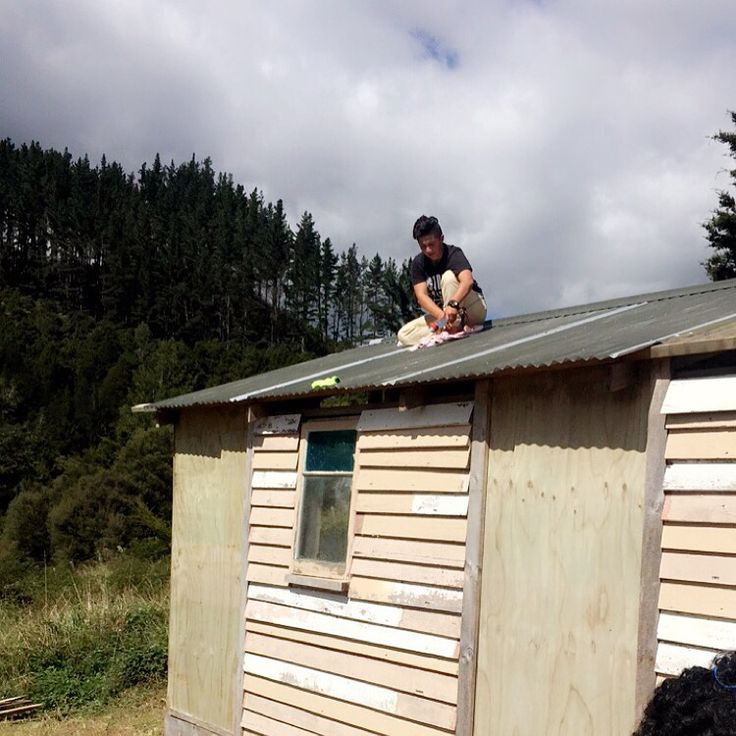 The roofing iron was pretty much brand new, however there were a couple of very small holes and this is another niece of ours Waitaha, who is filling in a couple of very small holes.