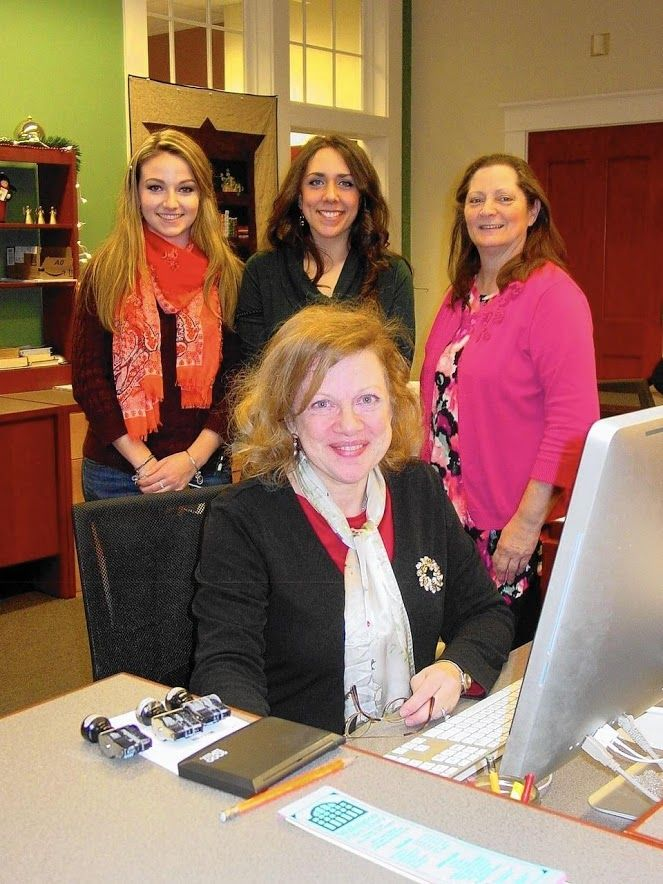 Photo by Kitty LeShay Courant Community Dec 2016  A few of the helpful staff at the WPL, Gwen Haaland seated . L-R Danielle Hart, Brittany McDougal Jensen, and Deb Linares. Courant Community Willington Public Library opened 10 years ago.  http://www.courant.com/community/willington/hc-sr-1222-willington-library-20161221-story.html