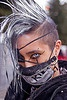 punk fashion, burning man decompression, color contact lenses, dereck, ear piercing, eye liner, eye patch, eyebrow piercing, make-up, mohawk hair, mouth mask, special effects contact lenses, theatrical contact lenses, white contact lenses, white contacts, white mohawk, zippers, stock photo