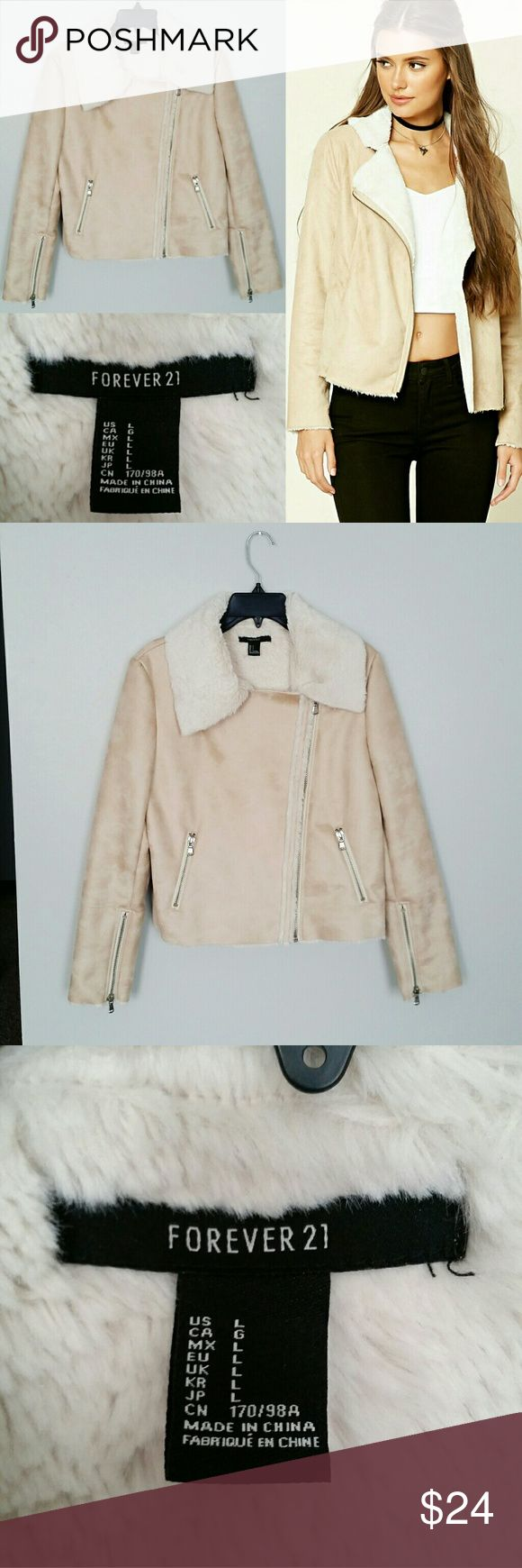 NWOT F21 Faux Fur Lined Faux Suede Moto Jacket NWOT no flaws. Material info on photos. Tag says large, fits more like a medium/small. All silver hardware. 2 zipper pockets, 2 zippers at sleeves, and zipper front closure. Very soft faux suede material, lining is extremely soft faux fur material. Armpit to armpit 19 inches, neck to hem 17 inches, sleeves 17 inches, width at hem 19 inches. Forever 21 Jackets & Coats Blazers