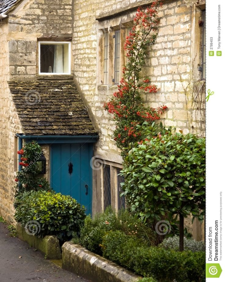 Shot in one of the picturesque villages in the Cotswolds, a cottage with blue front boor and red roses climbing up the wall. Description from dreamstime.com. I searched for this on bing.com/images