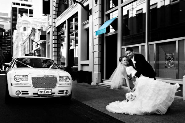 Great wedding photo with a white Chrysler 300c and a splash of Blue.. Thanks Bellagio Limousines