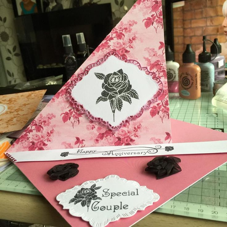 corner easel card using Phill Martin double sided papers, rose stamp and greeting, behind the easel is the anniversary verse stamp