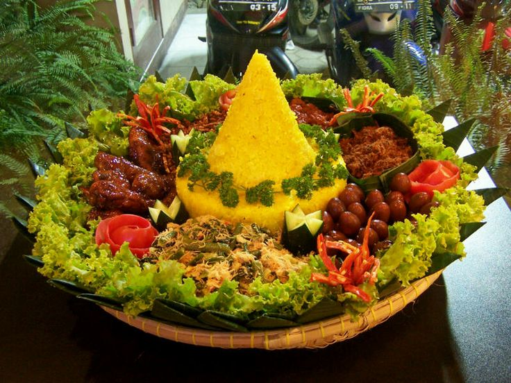"""this is not tart or any kind of cake , this is """"tumpeng nasi kuning"""" (yellow rice tumpeng) .."""