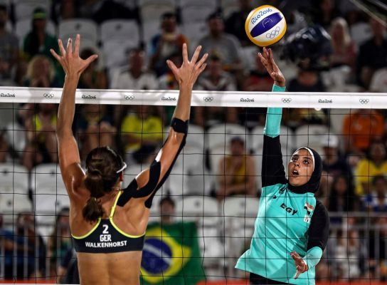 Doaa Elgobashy of Egypt (R) spikes the ball against Kira Walkenhorst of Germany (L) during the women's Beach Volleyball preliminary pool D game between Ludwig/Walkenhors of Germany and Elghobashy/Nada of Egypt the Rio 2016 Olympic Games at the Beach Volleyball Arena on Copacabana Beach in Rio de Janeiro, Brazil, 07 August 2016.