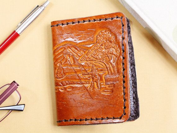 Hand Carved Fisherman Wallet, Hand Carved Leather Wallet, Gift For Dad. Repin To Remember. #fisherman, #fishermanwallet, #fishing, #fishingwallet, #fishinggift, #handcarvedleather, #wallet, #leatherwallet, #handcarvedwallet, #handtooledleather, #bifoldwallet, #leatherbifoldwallet, #handmadewallet, #creditcardwallet, #leather, #etsyshop, #etsyfinds, #etsygifts, #handmade, #handmadewithlove, #tinasleathercrafts.