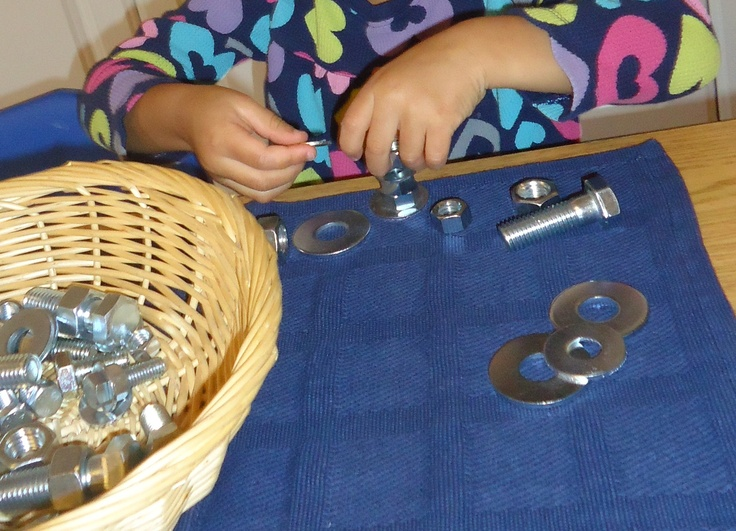 A bowlful of washers, nuts, and bolts to explore.