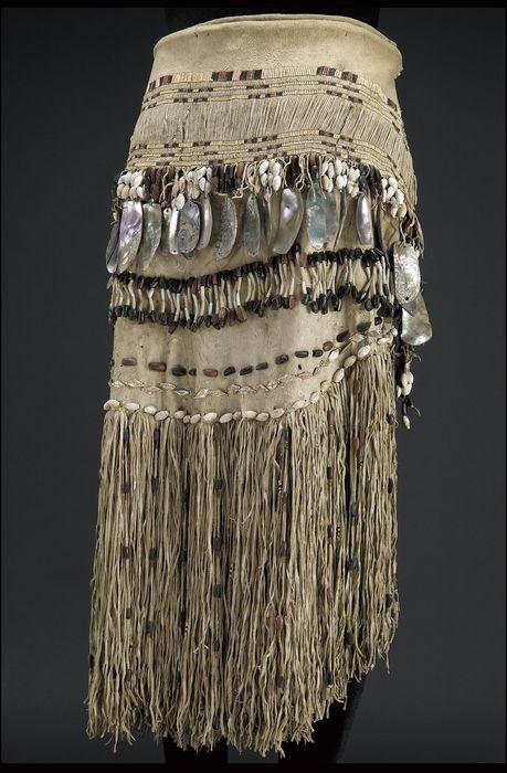 Woman's skirt, Hupa, circa 1880, Hide, abalone/haliotis shell, shell/shells, pine nut/nuts, bear grass, maidenhair fern stem. Sewn, strung, wrapped.