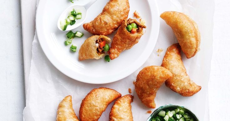 Dip these golden beef and veg curry puffs into a cool cucumber sauce for a tasty homemade snack.