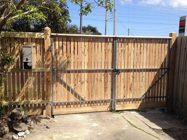 Vertical picket double driveway steel frame gate with ringlatch, drop bolts and padbolt