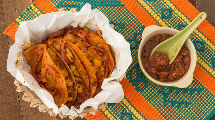 """Bring Mexico's street food to your kitchen with this easy-to-make recipe of tacos de canasta. Also known as tacos al vapor or tacos """"sudados"""", these tasty soft tacos are steamed in a large wicker basket. From carnitas and refried beans, to seasoned potatoes, the filling varies. Just make sure you avoid over hydrating the tortillas with meat and stew juices."""