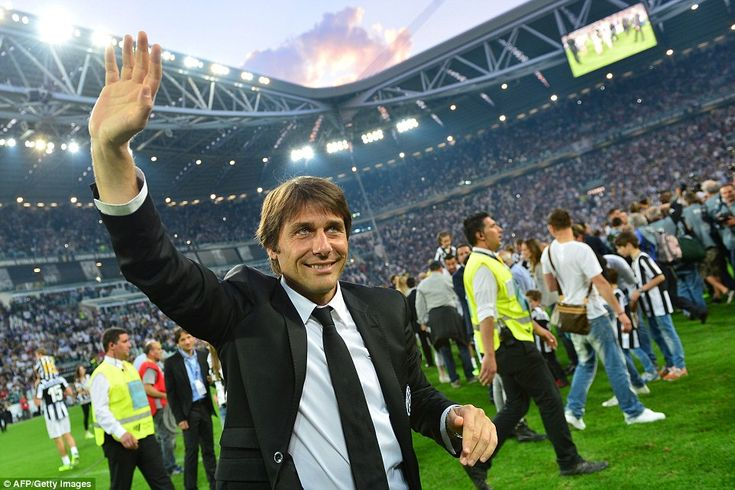 Conte waves to the Juventus fans following a game with Cagliari as he and his players celebrate becoming Serie A champions in 2013