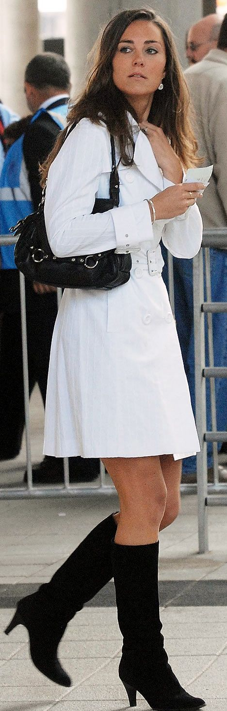 1 July 2007 Kate Middleton wore a white 'Olivia' trench coat by Reiss and black knee-high boots to the Concert for Diana, Wembley Stadium in London, England.
