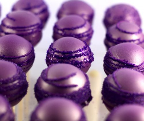Cake pops...easy to make ahead and make a cute display from. Plus it would be a good way to incorporate that deep purple color you like.