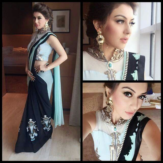 Lovely color combo! Pretty saree and stylish blouse!