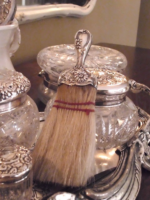Silver on dressing table brush and perfume bottles for Silver vanity table