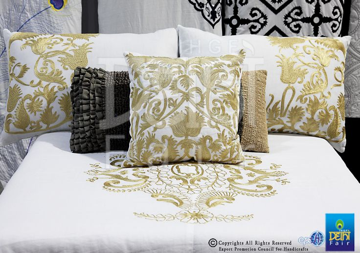 Delicate needlecraft florals and tendrils..flow across pristine Indian cottons at The IHGF Delhi Fair, Autumn 2015 #hometextiles #lifestyle #tradeshow